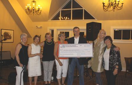 Quechee Lakes Landowners Association Charities present a check to CHaD's Child Advocacy and Protection Program.