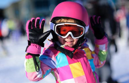 Girl in pink ski helmet