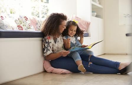 Mother reading to her daughter.