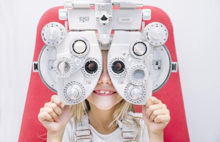 Young girl having her eyes tested.