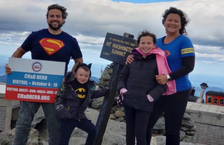 Harrison Family stands on Mt. Washington
