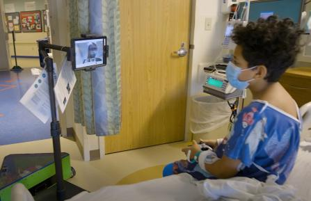 Photo of robot with patient