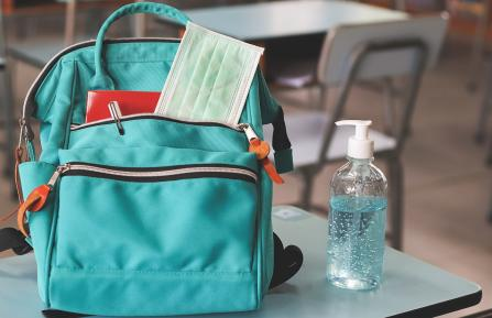 aqua backpack on school desk