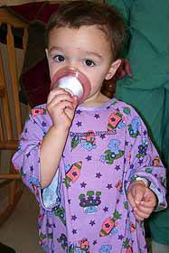 A child with a perioperative mask